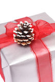 Christmas gift. Silver wrapped gift for Christmas or any other special winter celebration royalty free stock photos