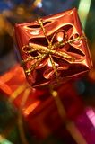 Christmas gift. Macro picture of red color Christmas gift decoration stock photo