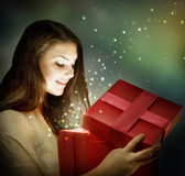 Christmas Gift. Beautiful woman with Christmas Gift.With copy-space