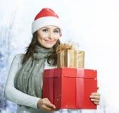 Christmas Gift. Beautiful Santa Girl with Christmas Holidays Gift Boxes Stock Photo