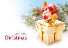 Christmas gift. Golden Christmas gift over white background with space for your text royalty free stock photos