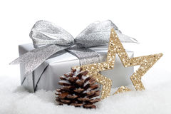 Christmas gift. A christmas gift and a star in snow - isolated on white Stock Photography