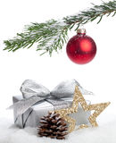 Christmas gift. A christmas gift and a star under the christmas tree in snow - isolated on white Royalty Free Stock Images