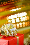 Christmas gift. Box with gold background royalty free stock image