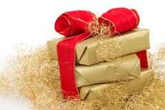 Christmas gift 2. Three golden gifts with a white background Royalty Free Stock Image