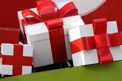 Christmas gift. White Christmas present wrapped in  red ribbon / bow Stock Image