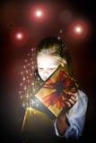 Christmas gift. Young girl with Christmas gift Royalty Free Stock Images