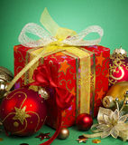 Christmas Gift. And baubles on green background Royalty Free Stock Photography
