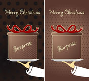 Christmas gift. On a tray at the waiter.Сhristmas card Royalty Free Stock Photos