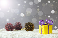 Christmas gift. Box on snow against defocused lights background Stock Photo