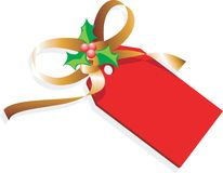 Christmas gift. Ribbon and a red tag Royalty Free Stock Images
