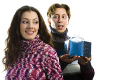 Christmas gift. A man and a woman exchanging Christmas gifts stock photo
