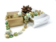 Christmas gift. Still life composed by boxes and necklace and colors Royalty Free Stock Photo