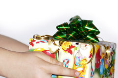 Christmas gift. Box with a christmas gift in hands at the girl Stock Image