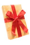 Christmas Gift. Yellow gift with red ribbon and bow. Isolated on a white background stock image