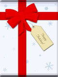 Christmas gift. Complete with ribbon, bow, and gift tag Royalty Free Stock Images