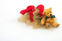 Christmas gift 5. Three golden gifts and a teddy with a white background Stock Photos