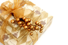 Christmas gift. Christmas presents wrapped in gold, isolated on a white background Stock Images