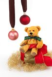 Christmas gift 7. Three golden gifts and a teddy and two Christmas balls with a white background Royalty Free Stock Photos