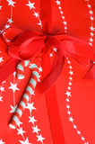 Christmas gift. Beautifully wrapped Christmas gift with candy cane and ribbon Royalty Free Stock Images