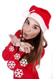 Christmas gift. Young woman sending cold kisses (snowflakes Royalty Free Stock Photos