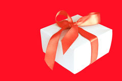 Christmas Gift. Isolatet on red background Stock Image