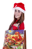 Christmas gift. Woman portraying father Christmas with a cheerful smile Stock Photo