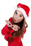 Christmas gift. Young woman sending love as a Christmas gift Royalty Free Stock Image