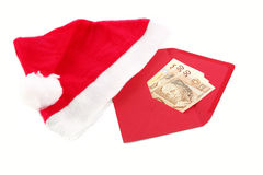 Christmas gift. Red envelope with a Christmas gift (Real / the Brazilian currency Royalty Free Stock Photo