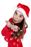 Christmas gift. Young woman sending (symbolic) money as a Christmas gift Stock Image