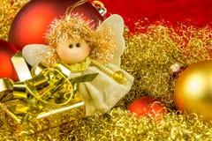 Christmas gift, angel and balls Stock Photo