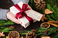 Christmas gift on the antique wooden background. Royalty Free Stock Images