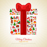 Christmas Gift Assembled from Icons with Red Ribbon Bow. Christmas Gift Assembled from Christmas Icons. Red Ribbon Bow. New Year Stickers on Beige Background Royalty Free Stock Photo