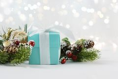 Christmas gift background with defocussed bokeh lights Royalty Free Stock Image