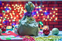 Christmas gift in the bag on the colorful lighting background Royalty Free Stock Images