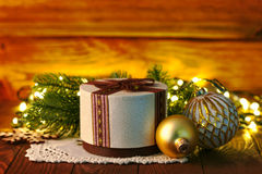 Christmas gift with ball and garland Royalty Free Stock Images