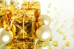 Christmas gift and balls. Christmas gold gift and balls on the white background stock photos