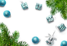 Christmas gift, balls, bells and fir tree branches. Top view Stock Image