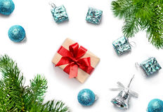 Christmas gift, balls, bells and fir tree branches. Top view Stock Images