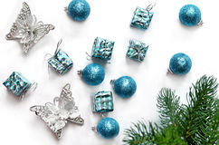 Christmas gift, balls, butterfly and fir tree branches. Top view Stock Photo
