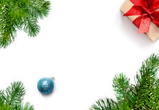Christmas gift, balls and fir tree branches. Top view Stock Photos