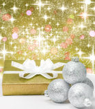 Christmas gift and baubles Stock Images