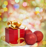 Christmas gift and baubles. Christmas gift  and baubles on the bokeh background Stock Image