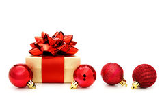 Christmas gift with baubles Stock Image