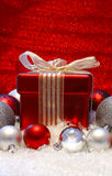 Christmas gift and baubles royalty free stock photography