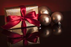 Christmas gift and baubles Stock Photo
