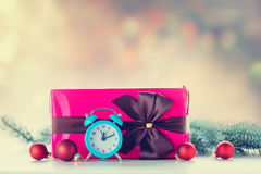 Christmas gift and baubles with clock Stock Photo