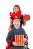 Christmas gift for a beautiful grandmother Stock Photography