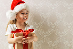 Christmas gift. Beauty childl with christmas gift Royalty Free Stock Photo