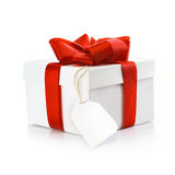 Christmas gift with blank tag Royalty Free Stock Photography